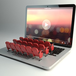 Video player app  or home cinema concept. Laptop and rows of cin